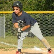 Boy leaning off base